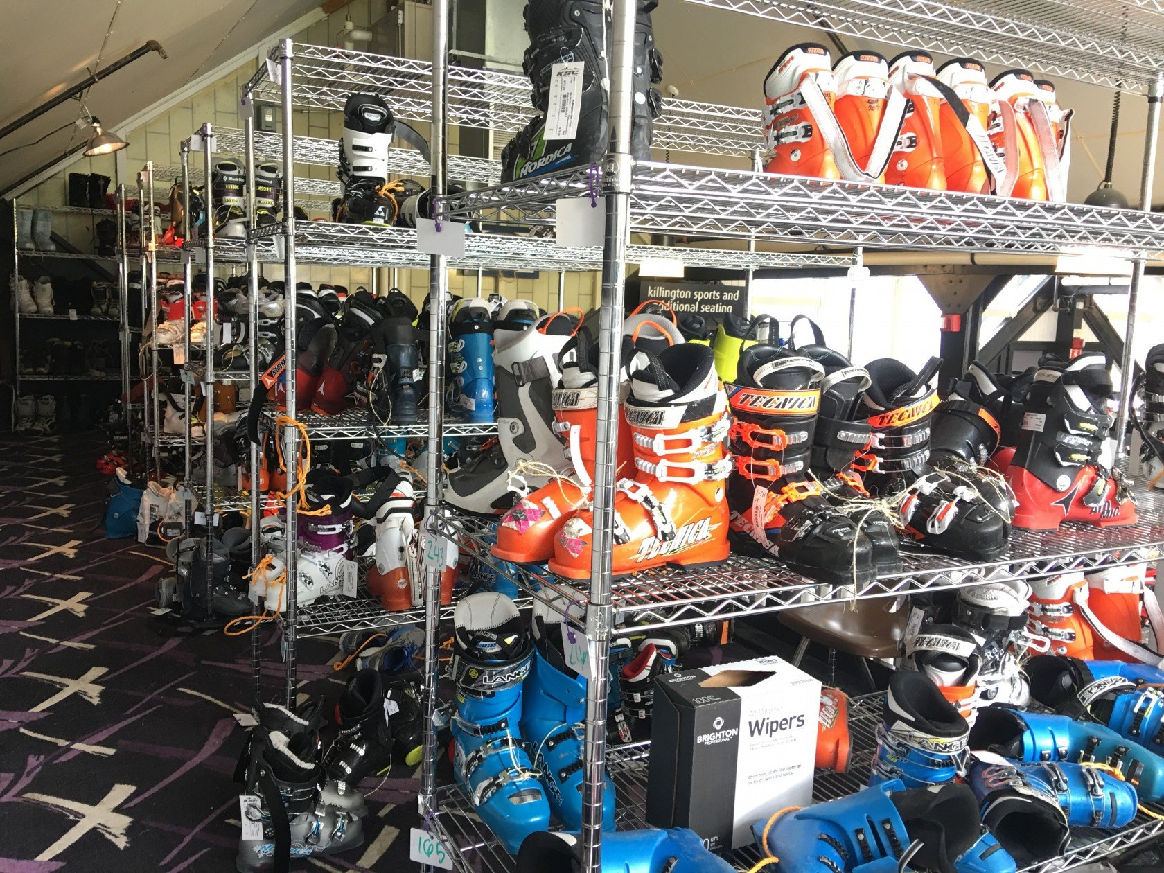Ski boots for sale at a ski swap. Shop a 2017 ski swap early for best selection.