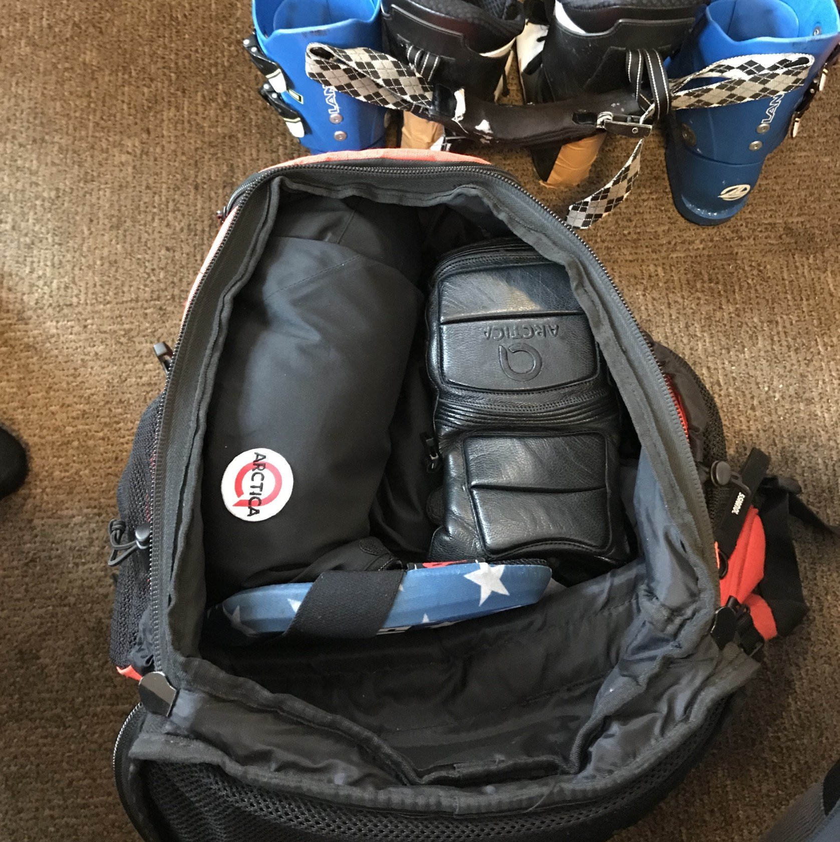 Ski racer's gear bag filled with Arctica gear.