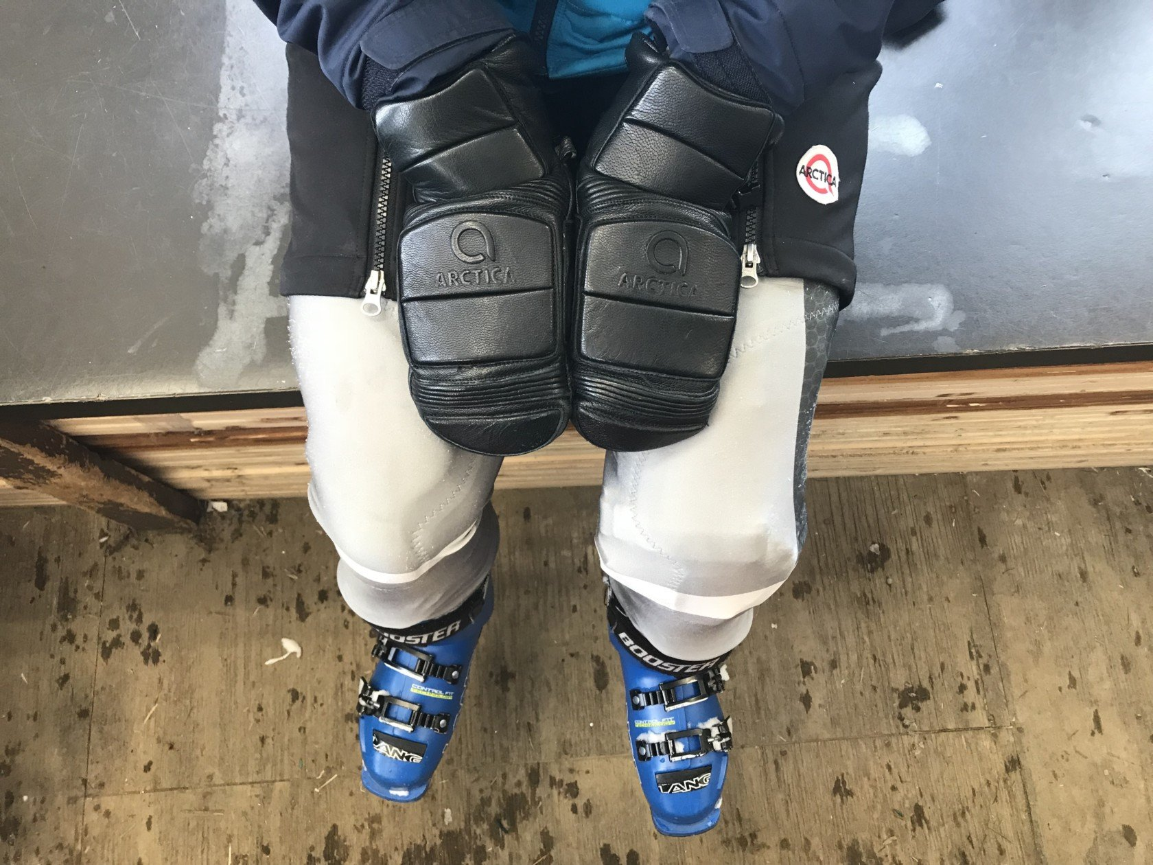 Ski racer in their Arctica race suit, shorts and mittens.