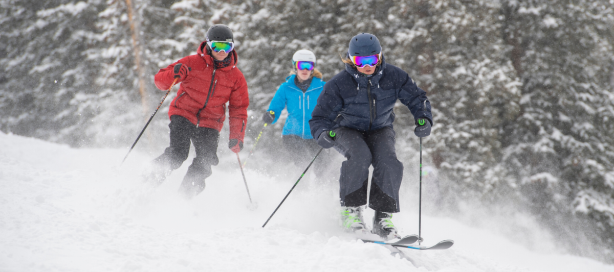 3 skiers wearing Arctica jackets and side zip pants