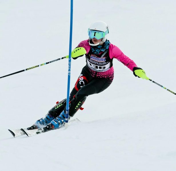 Young, female ski racer ski racing at the Wisconsin Ski and Snowboard Championships in her Arctica GS Speed Suit.