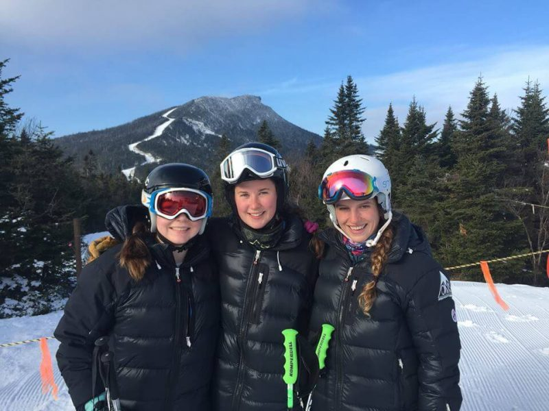 Okemo Mountain School athletes wearing their Arctica ski team winter jackets - the Pinnacle Down Jacket - the best down jacket for ski racers.