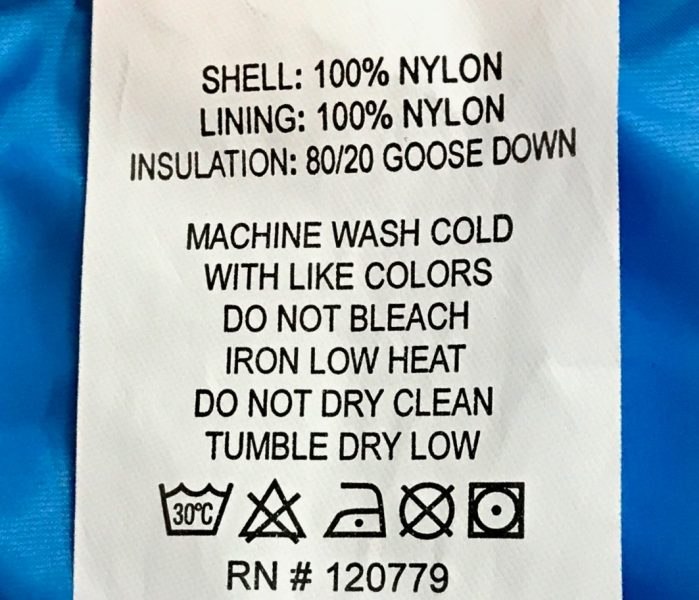 Fabric care label showing proper washing instructions for the Arctica Pinnacle Down Jacket , an 80/20 goose down ski jacket so you know how to wash your ski gear.
