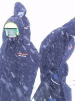 Wear an Arctica Race Cape for protection from the elements when ski racing.