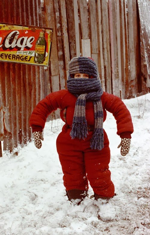 Randy from a Christmas Story can't put his arms down in his bulky down jacket and pants snow suit that could very well be made of made of 300 fill down. Down jackets for ski racers should not be bulky and heavy like this.