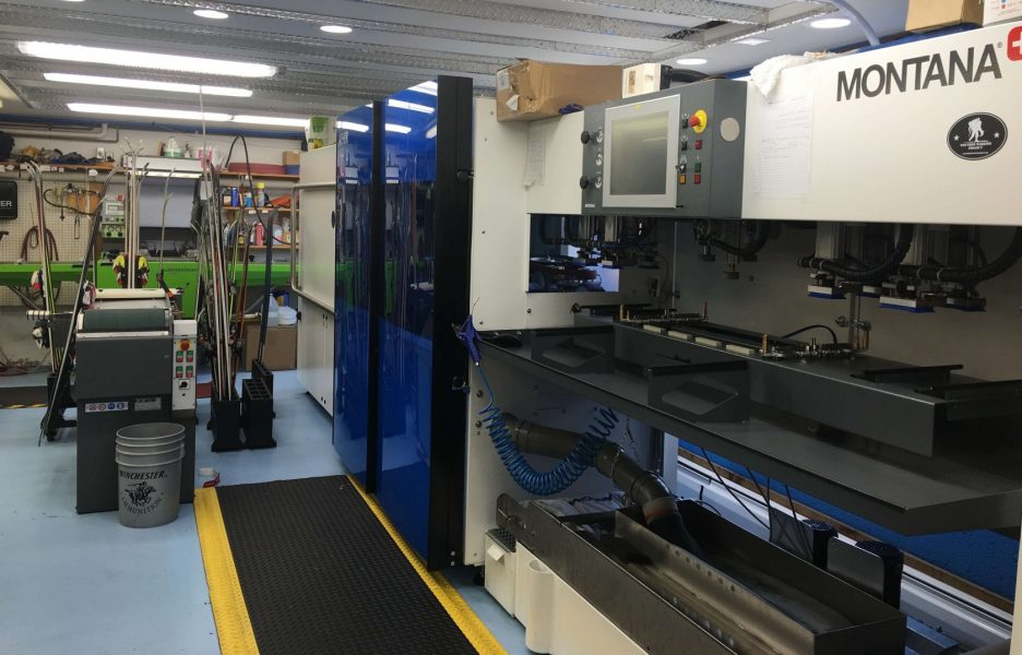 The ski tuning shop at Totem Pole Ski Shop with a Montana Saphir automated ski tuning machine for stone grinding ski bases and a Wintersteiger Trim Jet for ceramic disk edge finish.