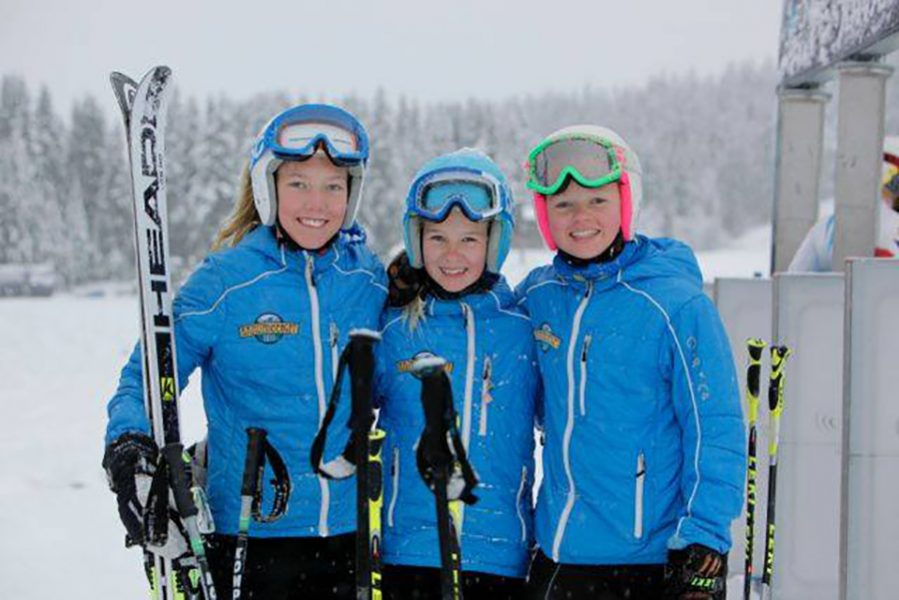 Three girls from the Täby Slalomklubb in Sweden after a day of training in their Arctica Speed Freak Team jackets. They also wear these jackets as an awards jacket on race day.
