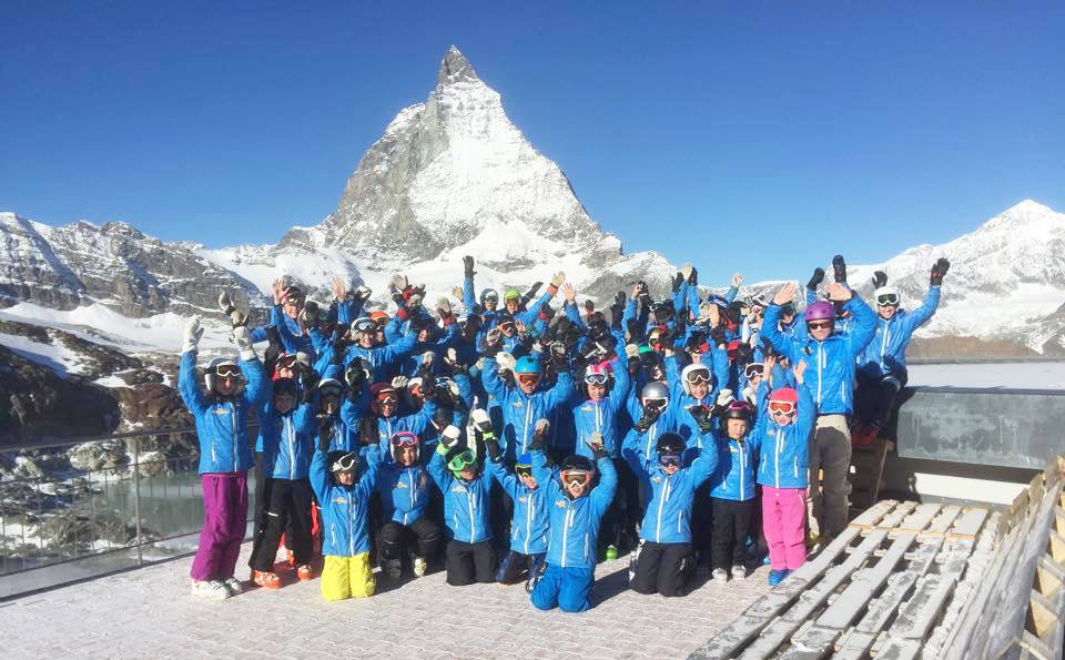 Taby Slalom Club of Sweden in their Arctica Speed Freak ski team jacket in Zermatt Switzerland