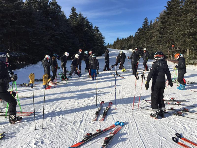 UConn Ski Team wearing their Arctica Pinnacle Down Training Jackets for ski race training. It is THE best down jacket for ski racers.