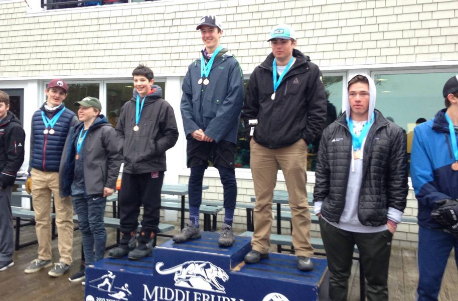 Ski racer Dylan Roussel on the podium at Vermont High School State Championships.